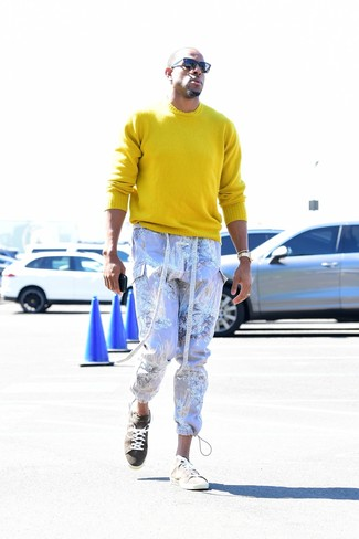 How to Wear a Yellow Crew-neck Sweater For Men: You'll be amazed at how extremely easy it is for any man to get dressed this way. Just a yellow crew-neck sweater paired with light violet print cargo pants. Beige suede low top sneakers integrate perfectly within a myriad of looks.