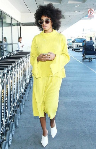 How to wear: yellow crew-neck sweater, yellow pleated midi skirt, white leather mules, dark brown sunglasses