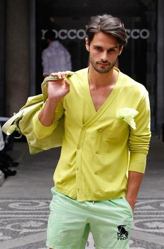 How to wear: yellow double breasted cardigan, mint shorts, yellow canvas duffle bag, white pocket square