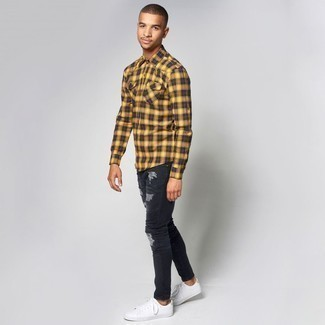 How to Wear Black Ripped Skinny Jeans For Men: Try pairing a yellow plaid flannel long sleeve shirt with black ripped skinny jeans for an outfit that's both edgy and practical. You can follow a classier route with footwear by rocking white low top sneakers.