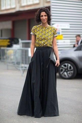 How to wear: yellow floral crew-neck t-shirt, black pleated maxi skirt, black and white print leather clutch