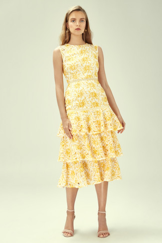 How to wear: yellow floral midi dress, beige leather heeled sandals, gold earrings