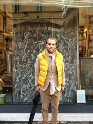 How to Wear Khaki Corduroy Chinos: A resounding yes to this casual combination of a yellow gilet and khaki corduroy chinos!