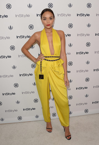 How to wear: yellow jumpsuit, black leather heeled sandals, black and gold leather waist belt