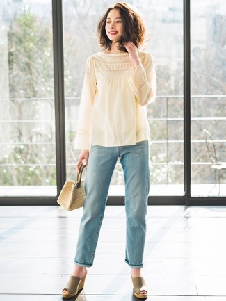 We give a big thumbs up to this pairing of a yellow long sleeve blouse and a handbag! For footwear go down the casual route with olive leather wedge sandals. You can bet this combo is great come summer.