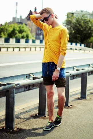 If you're facing a fashion situation where comfort is prized, try teaming a yellow long sleeve henley shirt with navy denim shorts. Rock a pair of sneakers for a more relaxed feel. A neat look like this one is just what you need on a hot hot weather day.