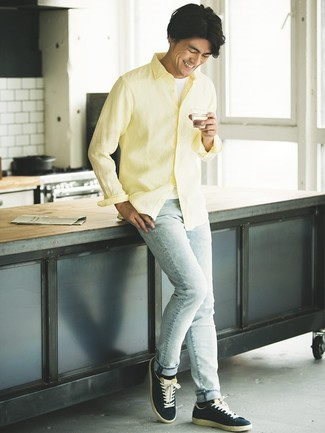 How to wear: yellow linen long sleeve shirt, white tank, light blue skinny jeans, navy suede low top sneakers