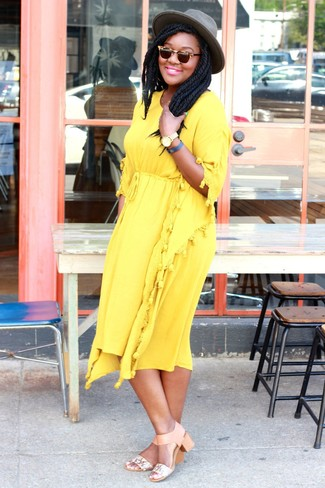 A yellow midi dress and a Rag and Bone Rag Bone Floppy Brim Fedora are great staples that will integrate perfectly within your current looks. A cool pair of beige leather heeled sandals is an easy way to upgrade your look. If you're searching for a summer-friendly outfit to prove you're the bomb, this just might be it.