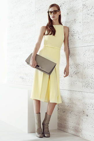 How to wear: yellow midi dress, grey leather ankle boots, grey leather clutch, brown sunglasses