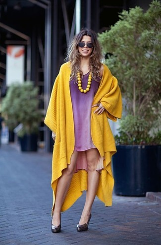 Purple dress yellow cardigan