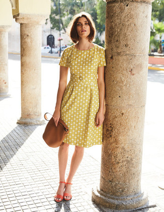 How to wear: yellow print fit and flare dress, orange leather heeled sandals, brown leather bucket bag