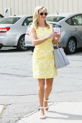 Go for a yellow print sheath dress for a refined yet off-duty ensemble. Look at how well this outfit is finished off with white leather heeled sandals. Stick with this one if you're after a great summertime look.
