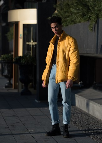 How to Wear Light Blue Jeans For Men: You'll be amazed at how very easy it is for any guy to get dressed like this. Just a yellow puffer jacket and light blue jeans. A pair of black leather casual boots looks perfect finishing your look.