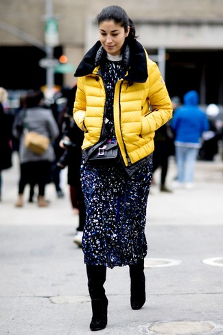 How to wear: yellow puffer jacket, navy print midi dress, black suede knee high boots, black embellished leather crossbody bag