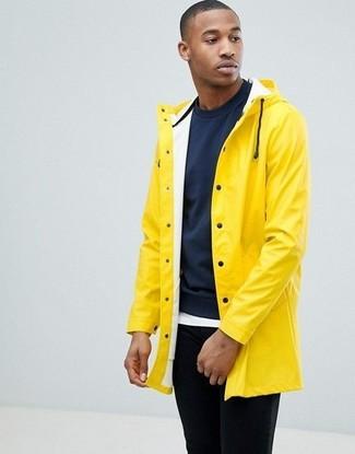 How to wear: yellow raincoat, navy sweatshirt, white crew-neck t-shirt, black chinos