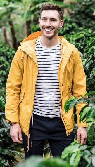 How to wear: yellow raincoat, white and black horizontal striped crew-neck t-shirt, navy dress pants, brown leather watch