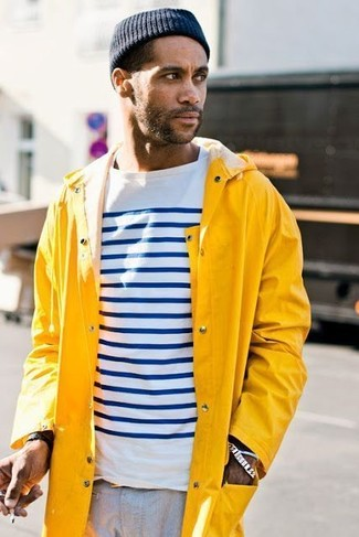 How to wear: yellow raincoat, white and navy horizontal striped long sleeve t-shirt, grey chinos, navy beanie