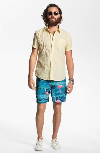 How to wear: yellow short sleeve shirt, aquamarine print shorts, beige low top sneakers