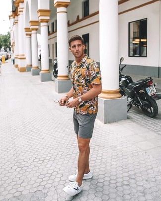 How to wear: yellow floral short sleeve shirt, grey shorts, white leather low top sneakers, tan leather watch