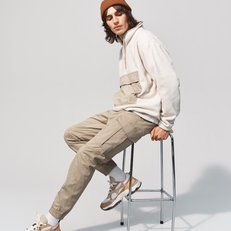 Khaki Cargo Pants Outfits: Extremely stylish, this casual combination of a white fleece zip neck sweater and khaki cargo pants brings variety. And if you want to instantly play down this look with footwear, add a pair of tan athletic shoes to this getup.