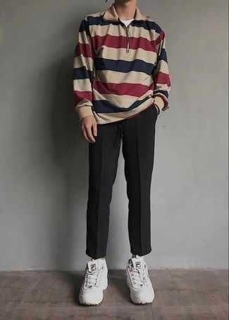 How to Wear White Athletic Shoes For Men: Extremely stylish and practical, this off-duty combination of a multi colored zip neck sweater and black chinos provides with excellent styling opportunities. White athletic shoes will add an easy-going vibe to an otherwise dressy outfit.