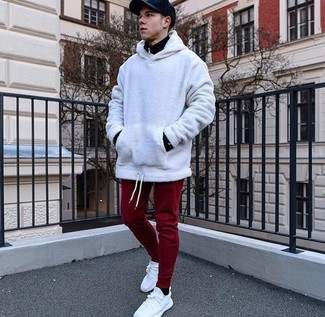 How to wear: black zip neck sweater, white hoodie, burgundy sweatpants, white canvas low top sneakers
