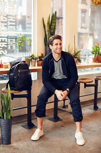 How to wear: navy zip sweater, white and black horizontal striped crew-neck t-shirt, black chinos, white leather low top sneakers
