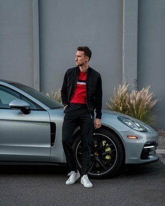 1200+ Outfits For Men In Their 20s: A black quilted zip sweater looks so cool when matched with black chinos. Introduce a pair of white leather low top sneakers to the mix and the whole ensemble will come together. This pairing demonstrates how to kill it in casual dressing as a gent in his twenties.