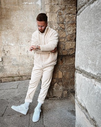 White Socks Outfits For Men: This combo of a beige fleece zip sweater and white socks is hard proof that a safe casual outfit doesn't have to be boring. Our favorite of a myriad of ways to complement this ensemble is white leather low top sneakers.