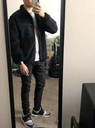 Black Skinny Jeans Outfits For Men: Prove that no-one does casual like you in a black fleece zip sweater and black skinny jeans. Complete this outfit with a pair of white and black athletic shoes to make the ensemble more practical.