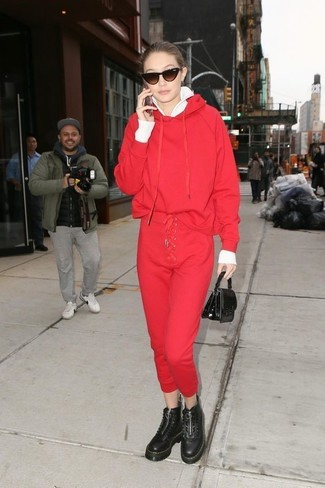 How to Wear a Red Hoodie For Women: Show off your styling chops by opting for this laid-back combo of a red hoodie and red sweatpants. Follow a more classic route with footwear by rounding off with black chunky leather lace-up flat boots.