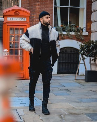 Navy Beanie Outfits For Men: Swing into something casual street style in a black and white fleece zip sweater and a navy beanie. Put an elegant spin on an otherwise simple look by finishing with black leather casual boots.
