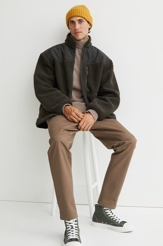 Tan Wool Turtleneck Outfits For Men: Putting together a tan wool turtleneck with brown chinos is a wonderful choice for a relaxed casual but dapper getup. If you need to instantly tone down this getup with a pair of shoes, add dark green canvas high top sneakers to this look.