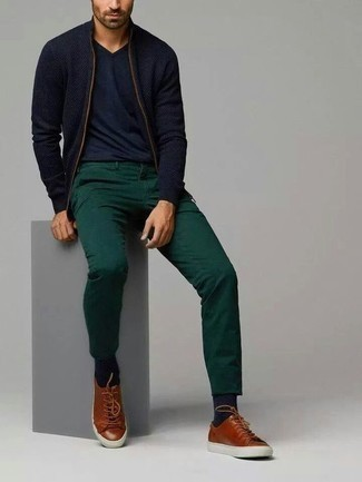 How to Wear a Navy Zip Sweater For Men: Dress in a navy zip sweater and dark green chinos to assemble an interesting and current laid-back ensemble. A pair of brown leather low top sneakers effortlessly ups the cool of this outfit.