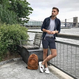 How to Wear a Grey V-neck T-shirt For Men: Choose a grey v-neck t-shirt and navy vertical striped shorts to be both city casual and sharp. If you don't know how to finish off, a pair of white low top sneakers is a goofproof option.