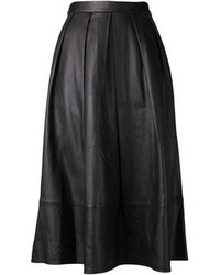 Wear a black shearling jacket with a midi skirt to achieve a chic look.
