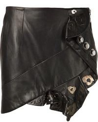 Pair studded leather booties with a mini skirt for a standout ensemble.