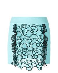 Minifalda con print de flores celeste de Emanuel Ungaro