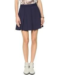 Minifalda plisada azul marino de Rebecca Minkoff