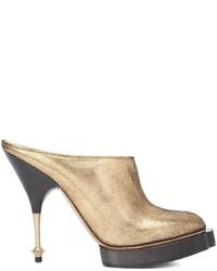 Mules en cuir dorées Vivienne Westwood