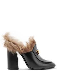 Mules en cuir noires Gucci