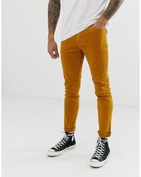 ASOS DESIGN Skinny Jeans In Mustard