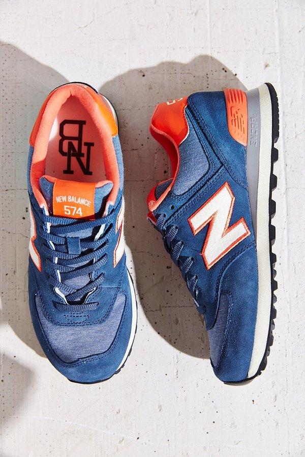 new balance 574 wearing orange