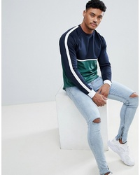 ASOS DESIGN Relaxed Longline Long Sleeve T Shirt With Contrast Yoke In Woven Fabric And Curve Hem