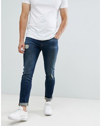 ASOS DESIGN 125oz Skinny Jeans With Rips And Abrasions In Dark Wash Blue