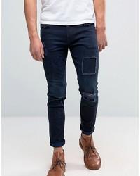 Asos Skinny Jeans With Rip And Repair In Dark Blue