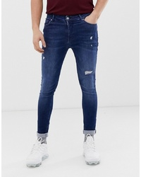 ASOS DESIGN Spray On Jeans With Power Stretch In Overydye Blue With Abrasions