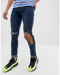 ASOS DESIGN Super Skinny Jeans In Dark Wash Blue With Open Rips