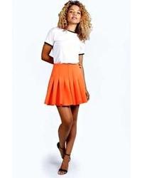 4af717bf7c Orange Pleated Mini Skirts for Women | Women's Fashion | Lookastic.com