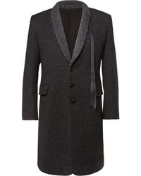 Dress in a black crew-neck sweater and an overcoat for drinks after work.